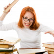 Beautiful red-haired girl in glasses reads book. — Stock Photo #9689696