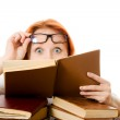 Beautiful red-haired girl in glasses reads book. — Stock Photo #9689993