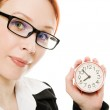 Pretty smiling woman holding a clock — Stock Photo