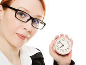 Pretty smiling woman holding a clock — Stockfoto