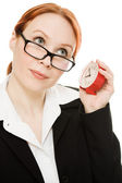 Businesswoman wearing glasses listening clock . — Stockfoto