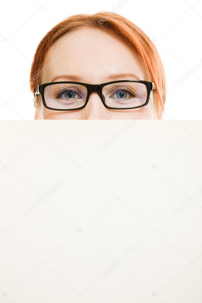 Business woman with glasses hidden behind a white sheet of paper — Stock Photo #9690890