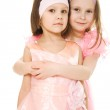 Two girlfriends hugging dresses in pink — Stock Photo #9739381