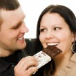 Stock Photo: Mfeeding womchocolate .
