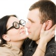 Funny woman in glasses wants to kiss a man — Stock Photo