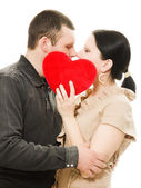 Man and woman kissing with a heart. — Stockfoto