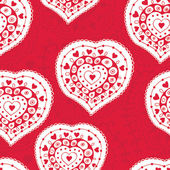 Ornate heart on seamless floral pattern with place for your text — Stock Vector