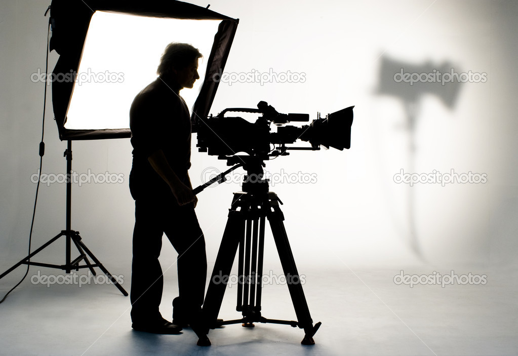 Cameraman silhouette and cameras. — Stock Photo #10664682