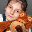 Foto Stock: Girl with bear