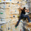 Womon rock wall in sport centre — Stock Photo #9779121