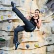 Woman on rock wall — Stock Photo