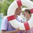 Young couple with ring-buoy — Stock Photo