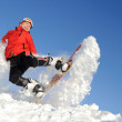 Young woman on snowboard — Stock Photo #9779321