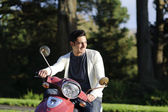 Handsome man drive scooter — Stock Photo