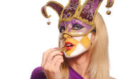 Woman in violet carnival mask — Stock Photo