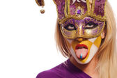 Woman in violet mask with blue pill on tongue — Stock Photo