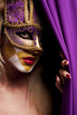 Sexy woman in violet party mask — 图库照片