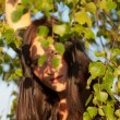 Girl among birch foliage — Stockfoto