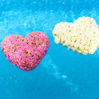 Flower hearts in water — Stock Photo