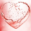 Stock Photo: Valentine heart made of blue water splash