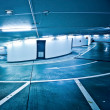 Empty underground parking lot area - Stock Photo