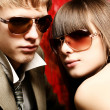 Stock Photo: Fashionable young couple wearing sunglasses
