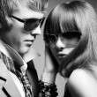 Fashionable young couple wearing sunglasses — Stock Photo #9442134
