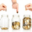 Glass banks for tips with money like diagram and hand — Stock Photo #10060946