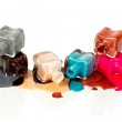 Nail polish dripping from stacked bottles — Stock Photo