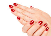 Vicino di mani femminili con manicure rosso — Foto Stock