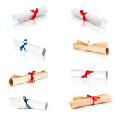 Collection of rolls white paper and papirus with ribbons — Stock Photo