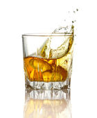 Splash in glass of whiskey and ice isolated — Stock Photo