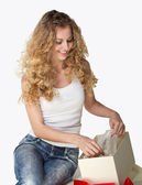 Blond girl with present — Stock Photo