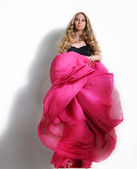 Woman in long pink dress — Stock Photo