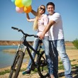 Happy smiling couple with balloons — Stock Photo #10600469