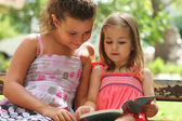 Children reading the book — Stock Photo