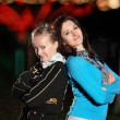 Young smiling girls in the night park — Stock Photo