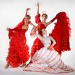 Three young women dancing flamenco — Stock Photo