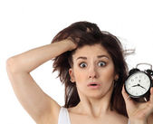 Surprised woman holding clock — Stock Photo