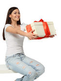 Beautiful young brunette girl with present — Stock Photo
