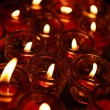 Lignting of Praying candles in a temple. — Stockfoto