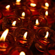 Lignting of Praying candles in a temple. — Foto de Stock