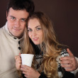 Portrait of a happy young couple with cup — Stock Photo #8986135