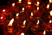 Lignting of Praying candles in a temple. — Stock Photo