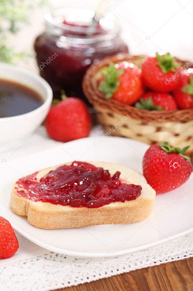 Tasty fresh breakfast with strawberry in the sunny morning  Stock Photo #9293295