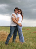 Couple in love in the summer field — Stock Photo