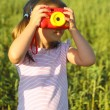 Portrait of the little girl with toy camera — Stock Photo