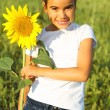 Portrait of a cute little girl with sunflower — Stock Photo