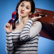 Portrait of the lovely woman with suitcase — Stock Photo
