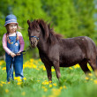 Child and small horse in the field — Stock Photo #10209931